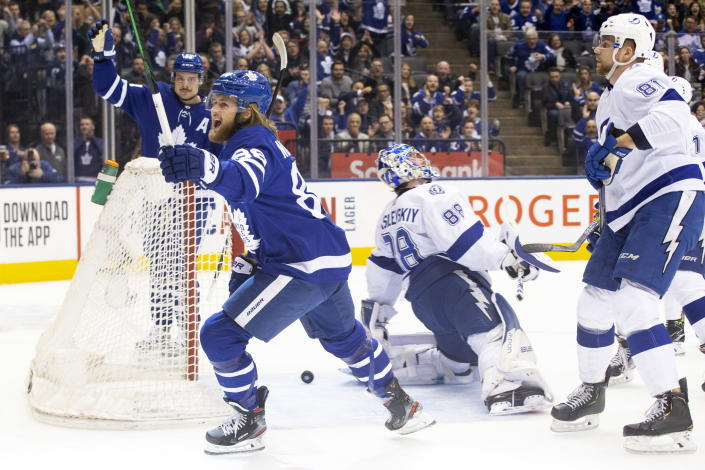 Toronto Maple Leafs right wing William Nylander, front left, celebrates after scoring on Tampa Bay Lightning goaltender Andrei Vasilevskiy, middle, during the first period of an NHL hockey game Tuesday, March 10, 2020, in Toronto. (Chris Young/The Canadian Press via AP)