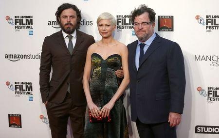 "Actors Casey Affleck, Michelle Williams and director Kenneth Lonergan pose for photographers at a Gala screening of their film ""Manchester by the Sea"" at the 60th BFI London Film Festival in London"