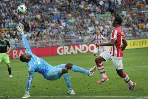PSV Eindhoven's Georginio Wijnaldum (R) scores the 4-2 goal against Ajax Amsterdam during the Johan Cruyff Shield, a football trophy named after legendary Dutch football player Johan Cruyff, also often referred to as the Dutch Super Cup, on August 5, in Amsterdam. PSV won 4-2