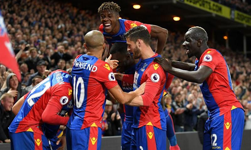 Yohan Cabaye of Crystal Palace is mobbed by team-mates after scoring the second goal against Arsenal at Selhurst Park.