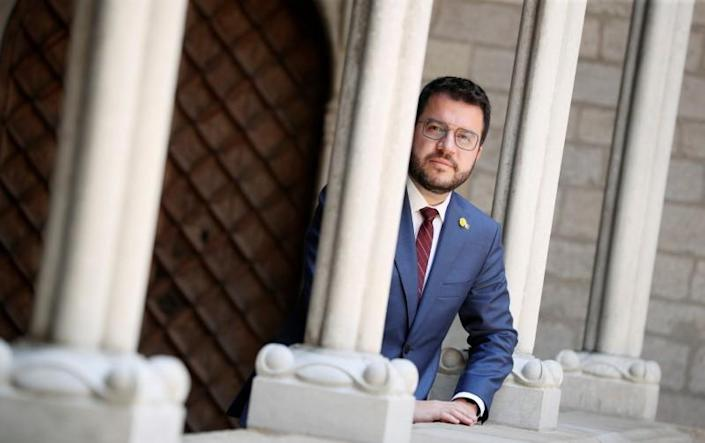 Catalonia's regional head of government Pere Aragones poses during an interview at Palau de la Generalitat in Barcelona