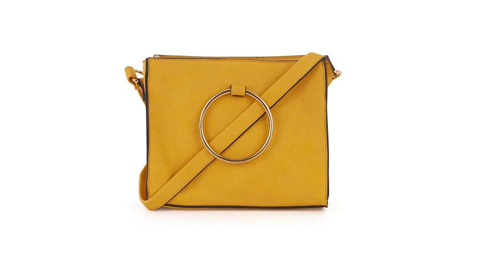 """<p>It's not all about straw bags this season, thanks to a pop of colour over at Warehouse. Look for accessories with supersized handles for added style points. <em><a href=""""http://www.warehouse.co.uk/gb/accessories/bags-and-purses/ring-detail-boxy-crossbody/031111.html?dwvar_031111_color=82&position=41&cgid=bags#&start=41&categoryID=bags"""" rel=""""nofollow noopener"""" target=""""_blank"""" data-ylk=""""slk:Warehouse"""" class=""""link rapid-noclick-resp"""">Warehouse</a>, £29</em> </p>"""