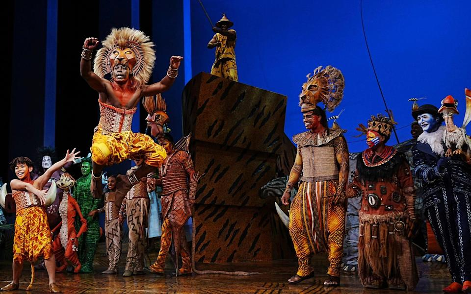 The Lion King cast in their first show back after the pandemic shutdown - AP/Charles Sykes