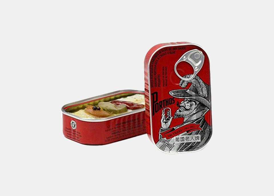 """""""This particular tinned fish comes from one of the oldest canned fish factories in Portugal,"""" says George Mendes, chef and partner at the newly-opened <a href=""""https://www.verandasoho.com/"""" rel=""""nofollow noopener"""" target=""""_blank"""" data-ylk=""""slk:Veranda"""" class=""""link rapid-noclick-resp"""">Veranda</a> in <a href=""""https://www.cntraveler.com/destinations/new-york-city?mbid=synd_yahoo_rss"""" rel=""""nofollow noopener"""" target=""""_blank"""" data-ylk=""""slk:New York City"""" class=""""link rapid-noclick-resp"""">New York City</a>, whose menu pays homage to his Portuguese roots. """"The spice used really gives the sardines another dimension, and since they're drenched in olive oil, I like to eat them on a thick, fresh, toasted, crusty piece of sourdough bread."""" (Need a gift for a sardine-loving friend? New England-based <a href=""""https://cna.st/affiliate-link/Bmaj1V9t4nDfMf7AwtuLqibuvBt74LsG7BbZXDXtZpYdNkhawWVqnNt6kCrLdS6Bk4YSkLp7hNx7WXrx41qhwAdeDBc8sjbS4TgvvqZNmZVQEpTFLeBJjStfGbmAygBv2YbFDs4CZkys7wCJ9Y6BEogrHFhH2kCK1ioLw6mm?cid=609a9910eb3a8c5cf2895e0c"""" rel=""""nofollow noopener"""" target=""""_blank"""" data-ylk=""""slk:Portugalia Marketplace sells a set"""" class=""""link rapid-noclick-resp"""">Portugalia Marketplace sells a set</a> with five flavors of the brand's tinned fish, packed in a wooden crate.) $30, Amazon. <a href=""""https://www.amazon.com/Spiced-Sardines-olive-Porthos-Portugal/dp/B079XQZF27"""" rel=""""nofollow noopener"""" target=""""_blank"""" data-ylk=""""slk:Get it now!"""" class=""""link rapid-noclick-resp"""">Get it now!</a>"""