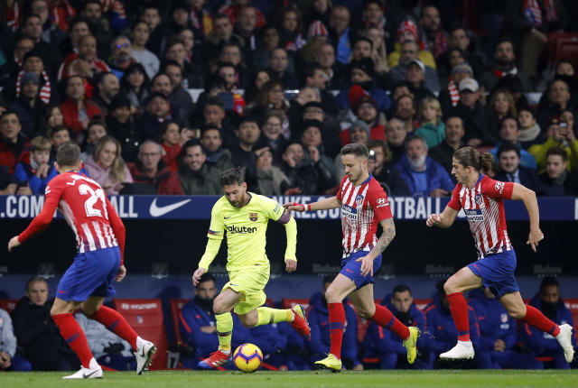 Barcelona's Lionel Messi, 2nd left, runs with the ball during a Spanish La Liga soccer match between Atletico Madrid and FC Barcelona at the Metropolitano stadium in Madrid, Saturday, Nov. 24, 2018. (AP Photo/Paul White)