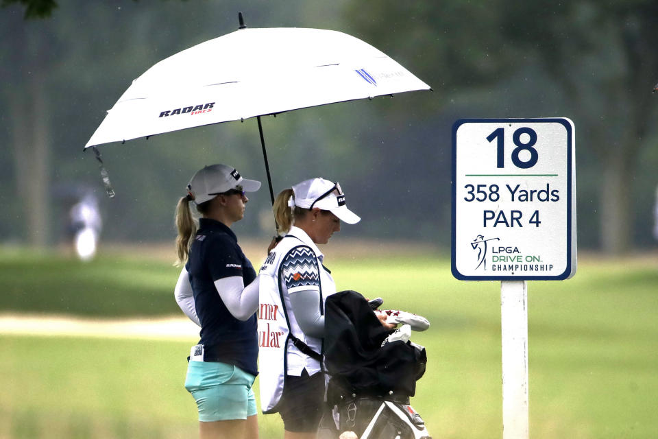 Jodi Ewart Shadoff, left, from England, waits to hit her tee shot on the 18th hole during the second round of the LPGA Drive On Championship golf tournament at Inverness Golf Club in Toledo, Ohio, Aug. 1, 2020. (AP Photo/Gene J. Puskar)