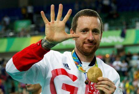 FILE PHOTO: Bradley Wiggins (GBR) of Britain poses with his gold medal at the Men's Team Pursuit Victory Ceremony