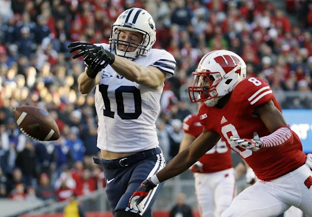 Wisconsin's Sojourn Shelton, right, breaks up a pass intended for Brigham Young's Mitch Mathews (10) during the first half of an NCAA college football game on Saturday, Nov. 9, 2013, in Madison, Wis. (AP Photo/Morry Gash)