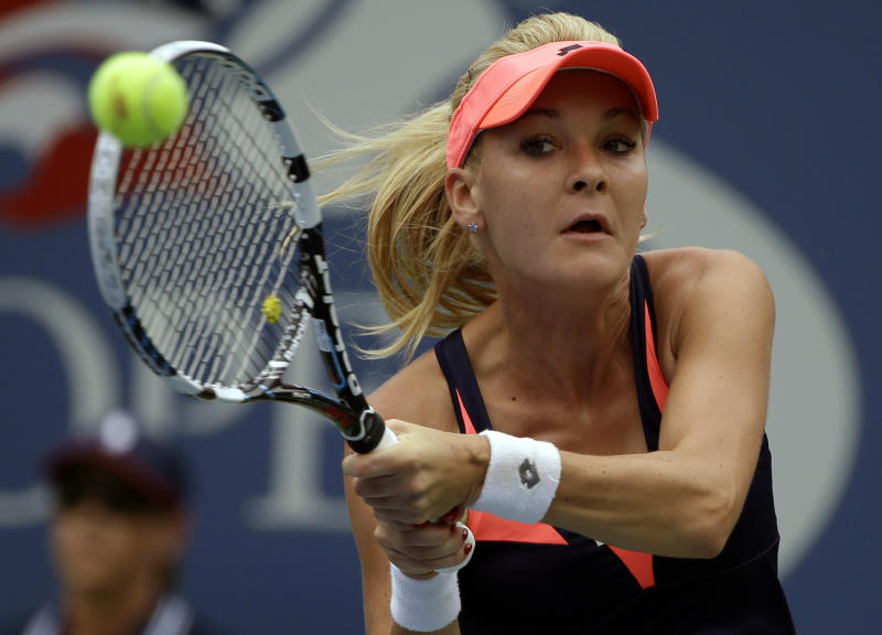 Agnieszka Radwanska, of Poland, returns a shot to Spain's Silvia Soler-Espinosa in the first round of the 2013 US Open tennis tournament, Monday, Aug. 26, 2013, in New York. (AP Photo/David Goldman)