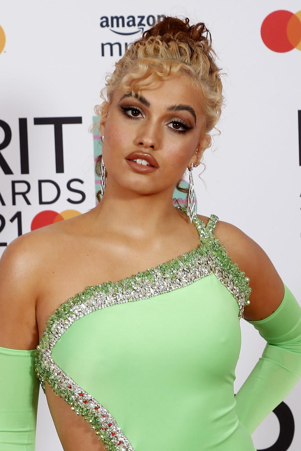 <p>Mabel looked ultraglam with '90s-style makeup by Nikki Wolff and a curled updo created by Rio Sreedharan. </p>