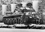 FILE - Tank crewmen bask in the sunshine beside their Soviet-made tank after taking station outside the Soviet Embassy in Kabul, Afghanistan, May 3, 1978. The former Soviet Union marched into Afghanistan on Christmas Eve, 1979, claiming it was invited by the new Afghan communist leader, Babrak Karmal, setting the country on a path of 40 years of seemingly endless wars and conflict. After the Soviets left in humiliation, America was the next great power to wade in. (AP Photo, File)