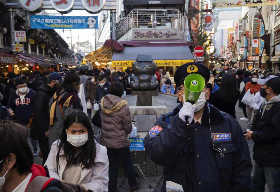 People flock to a shopping street for their yearend shopping in Tokyo Thursday, Dec. 31, 2020. (AP Photo/Hiro Komae)