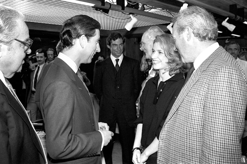 The Prince of Wales meets actress Caroline Bliss, 25, at Pinewood Studios. She plays Miss Moneypenny in the new James Bond film The Living Daylights.