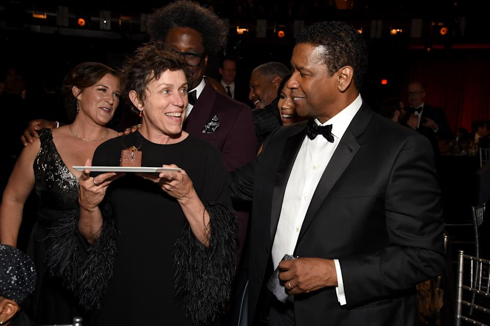 HOLLYWOOD, CALIFORNIA - JUNE 06: (L-R) Melissa Bell, Frances McDormand, W. Kamau Bell and Denzel Washington attend the 47th AFI Life Achievement Award honoring Denzel Washington at Dolby Theatre on June 06, 2019 in Hollywood, California. (Photo by Michael Kovac/Getty Images for AFI)