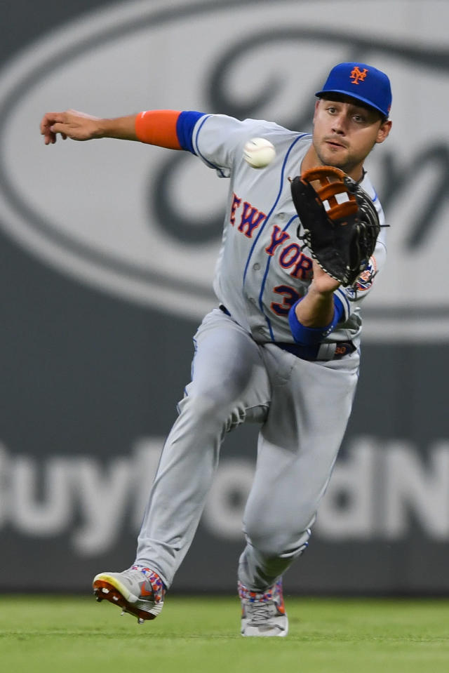 New York Mets right fielder Michael Conforto catches a line drive off the bat of Atlanta Braves' Freddie Freeman during the first inning of a baseball game Wednesday, Aug. 14, 2019, in Atlanta. (AP Photo/John Amis)