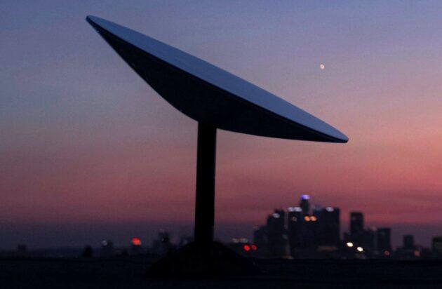 Starlink antenna with cityscape