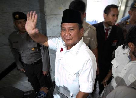FILE PHOTO: Indonesia's losing presidential candidate Prabowo waves as he leaves the Constitutional Court in Jakarta