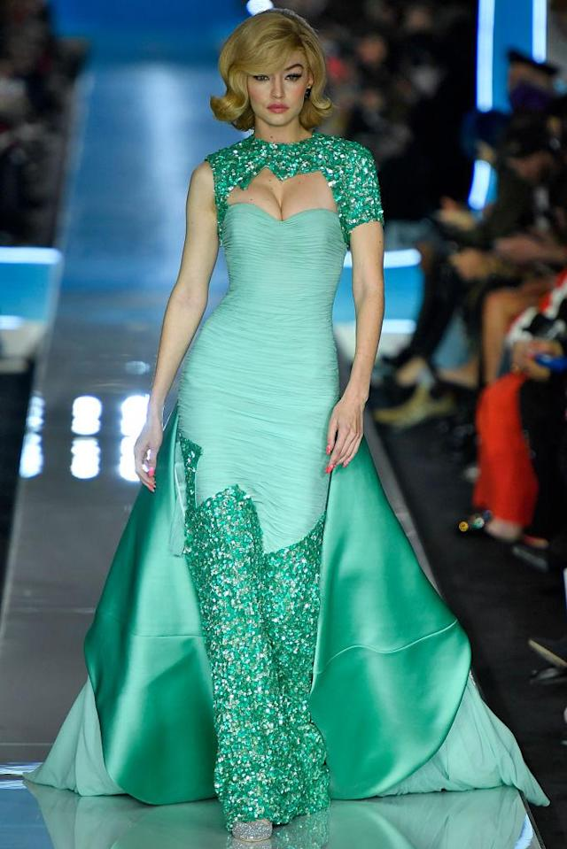 <p>Model Gigi Hadid wears a turquoise, embellished mermaid gown at the Moschino FW18 show. (Photo: Getty) </p>