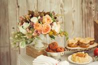 """<p>A blend of fall foliage and light-hued flowers is a charming touch to this <a href=""""https://www.elledecor.com/life-culture/food-drink/g3266/easy-thanksgiving-desserts/"""" rel=""""nofollow noopener"""" target=""""_blank"""" data-ylk=""""slk:already-sweet party table"""" class=""""link rapid-noclick-resp"""">already-sweet party table</a> (cinnamon donuts make a lovely fall treat) from <a href=""""https://urldefense.proofpoint.com/v2/url?u=http-3A__www.stylemepretty.com_living_&d=CwMF-g&c=B73tqXN8Ec0ocRmZHMCntw&r=1SKxxQCjta-pWEjaI7W4C1a9YhNhSr750SSHCTkjllE&m=RtIo9GQUy1khEGYgp_dhLgF7iED4v2a3drSrbCL13b0&s=gVfpQOnoKGz3oWUyfRWbe1qJQOcxkSJRSRv8QjqobQY"""" rel=""""nofollow noopener"""" target=""""_blank"""" data-ylk=""""slk:Style Me Pretty Living"""" class=""""link rapid-noclick-resp"""">Style Me Pretty Living</a>. </p>"""