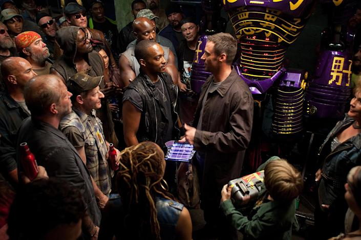A group of people standing around in a scene from Real Steel