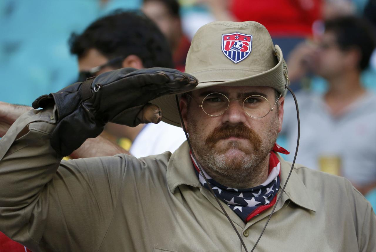 REFILE WITH ADDITIONAL INFORMATION  Mike D�Amico of the U.S., also known by his alter ego Teddy Goalsevelt, salutes before for the 2014 World Cup round of 16 game between U.S. and Belgium at the Fonte Nova arena in Salvador July 1, 2014. REUTERS/Sergio Moraes (BRAZIL - Tags: SOCCER SPORT WORLD CUP)