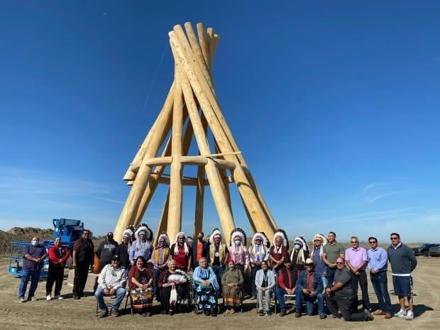 The Federation of Sovereign Indigenous Nations ceremonial teepee was erected in front of the new FSIN Building Monday.   (FSIN - image credit)