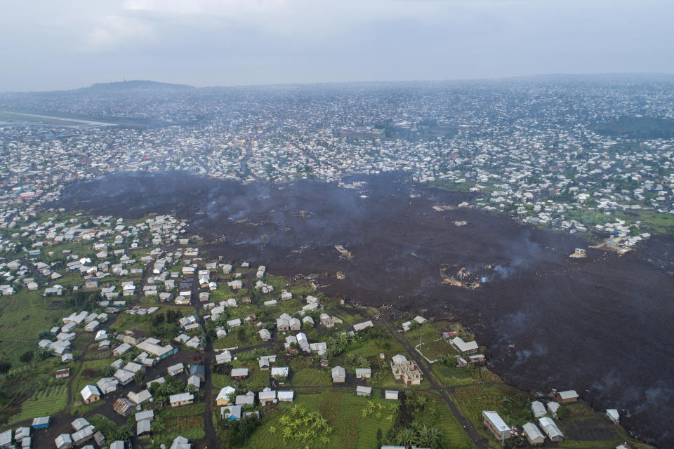 Lava from the eruption of Mount Nyiragongo cuts through Buhene, north of Goma. Source: AP/Justin Kabumba
