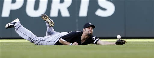 Chicago White Sox center fielder Jordan Danks dives for, but misses, a fly ball from Seattle Mariners' Endy Chavez in the first inning of a baseball game Tuesday, June 4, 2013, in Seattle. Chavez singled on the play. (AP Photo/Elaine Thompson)