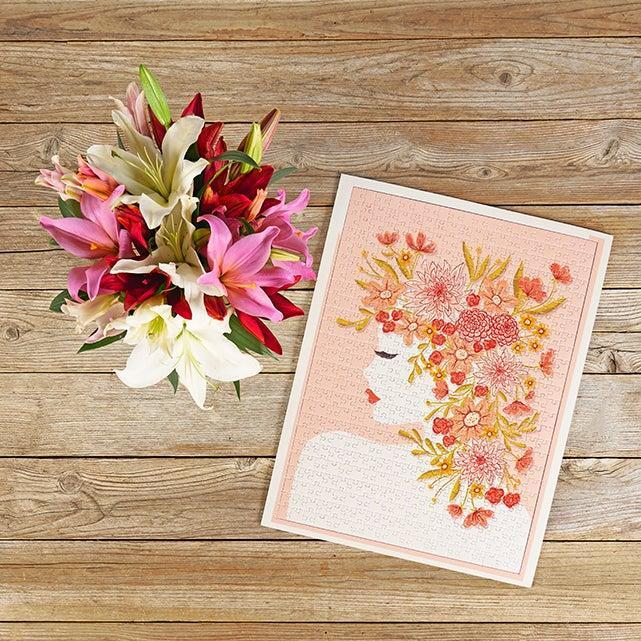 """-<strong>PAID-</strong><br><br><h2>""""Gettin' Jiggy With It"""" Bouquet & Jigsaw Puzzle Bundle</h2><br><br>Romantic affiliations aside, a bouquet of flowers is always a thoughtful gift. Not ONLY is this pink and white lily arrangement from The Bouqs Co. a playful alternative to traditional Valentine flowers, but it ALSO comes with a specially paired floral jigsaw puzzle from Jiggy. Which is to<br>say, this bundle offers plenty to keep you and a boo entertained on the 14th. (We're talking 450 pieces, here!)<br><br><em>Shop<strong> <a href=""""https://bouqs.com/flowers/valentines-day-gift-bundles/pink-white-red-lilies-jiggy-puzzle"""" rel=""""nofollow noopener"""" target=""""_blank"""" data-ylk=""""slk:The Bouqs Co."""" class=""""link rapid-noclick-resp"""">The Bouqs Co.</a></strong> </em><br><br><strong>The Bouqs Co</strong> Gettin' Jiggy With It, $, available at <a href=""""https://go.skimresources.com/?id=30283X879131&url=https%3A%2F%2Fbouqs.com%2Fflowers%2Fvalentines-day-gift-bundles%2Fpink-white-red-lilies-jiggy-puzzle"""" rel=""""nofollow noopener"""" target=""""_blank"""" data-ylk=""""slk:The Bouqs Co"""" class=""""link rapid-noclick-resp"""">The Bouqs Co</a>"""