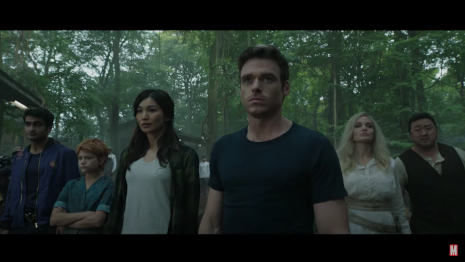 A group shot of Marvel's Eternals standing in the woods.