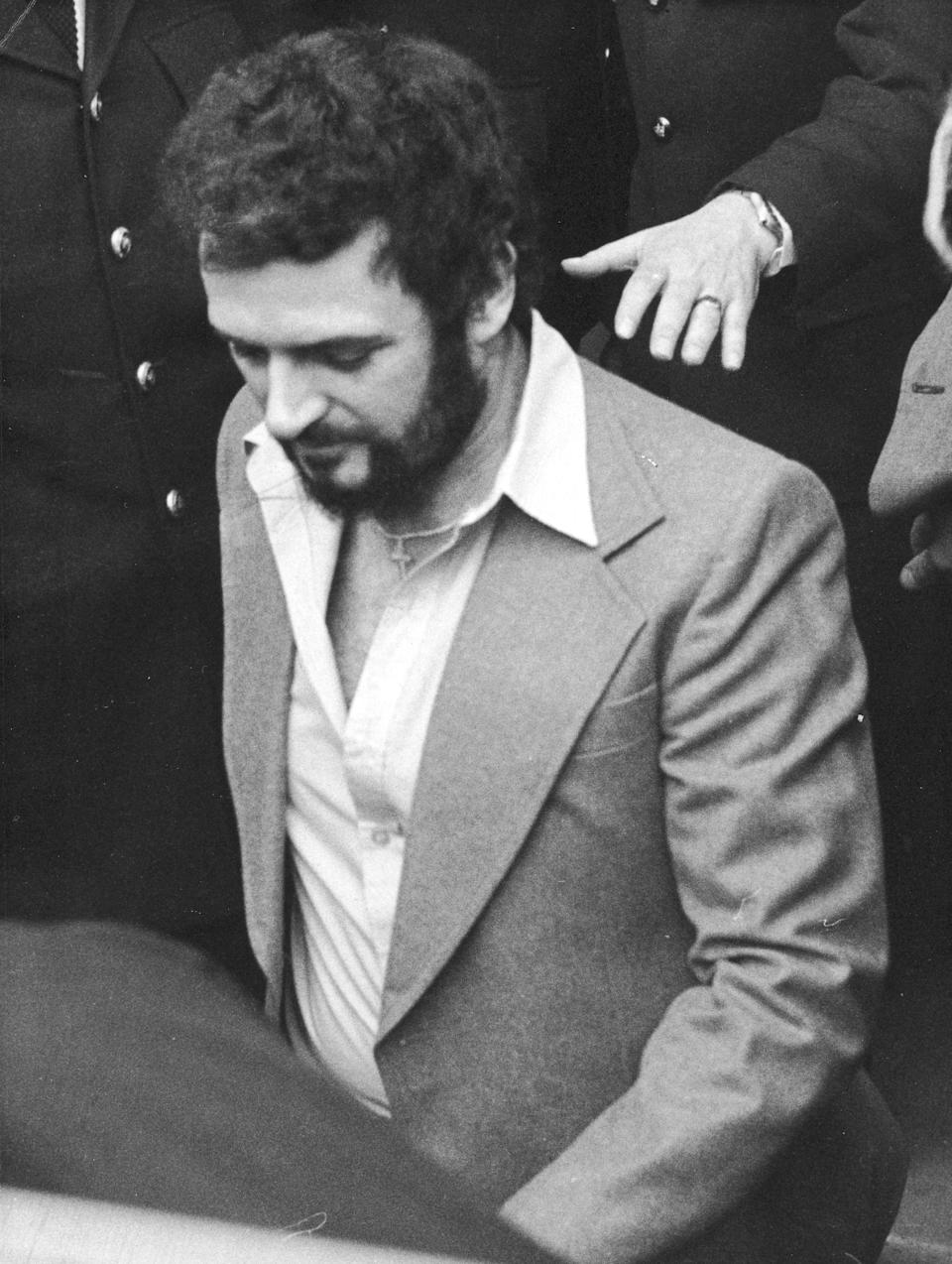 Sutcliffe, pictured in 1983, in police custody. (Express Newspapers/Getty Images)