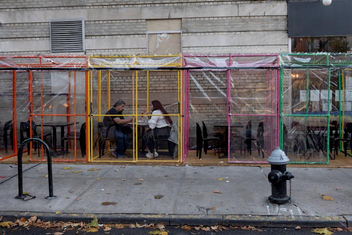 Customer's dine outdoors in individual tents in the West Village on November 26, 2020 in New York City. (Alexi Rosenfeld/Getty Images)