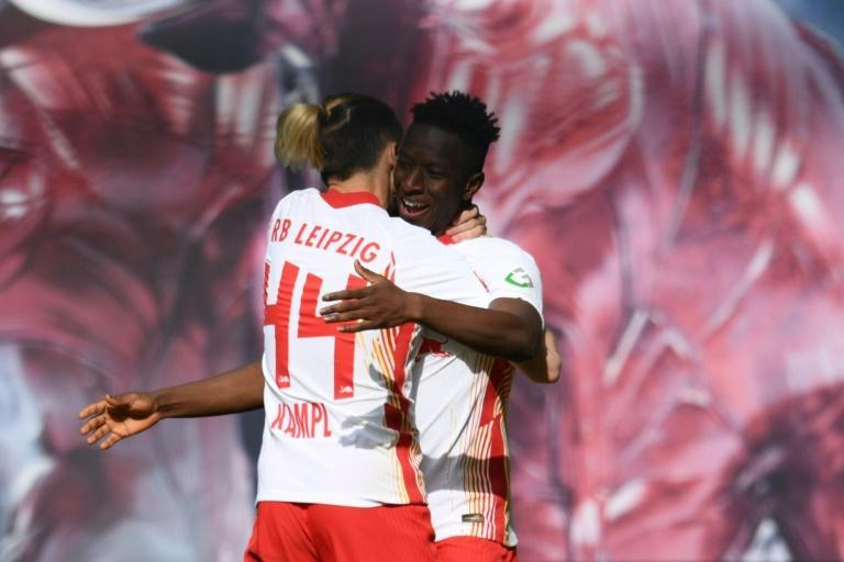 Amadou Haidara (R) celebrates his goal for RB Leipzig against Stuttgart with teammate Kevin Kampl