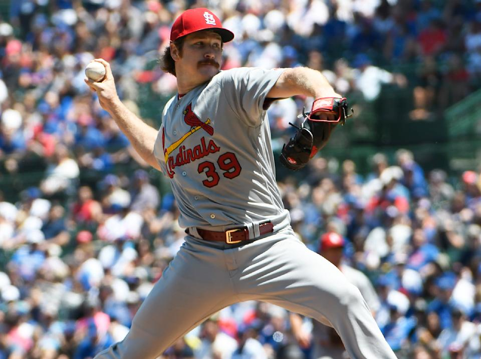 St. Louis Cardinals starting pitcher Miles Mikolas (39) delivers against the Chicago Cubs during the first inning of a baseball game, Friday, June, 7, 2019, in Chicago. (AP Photo/David Banks)