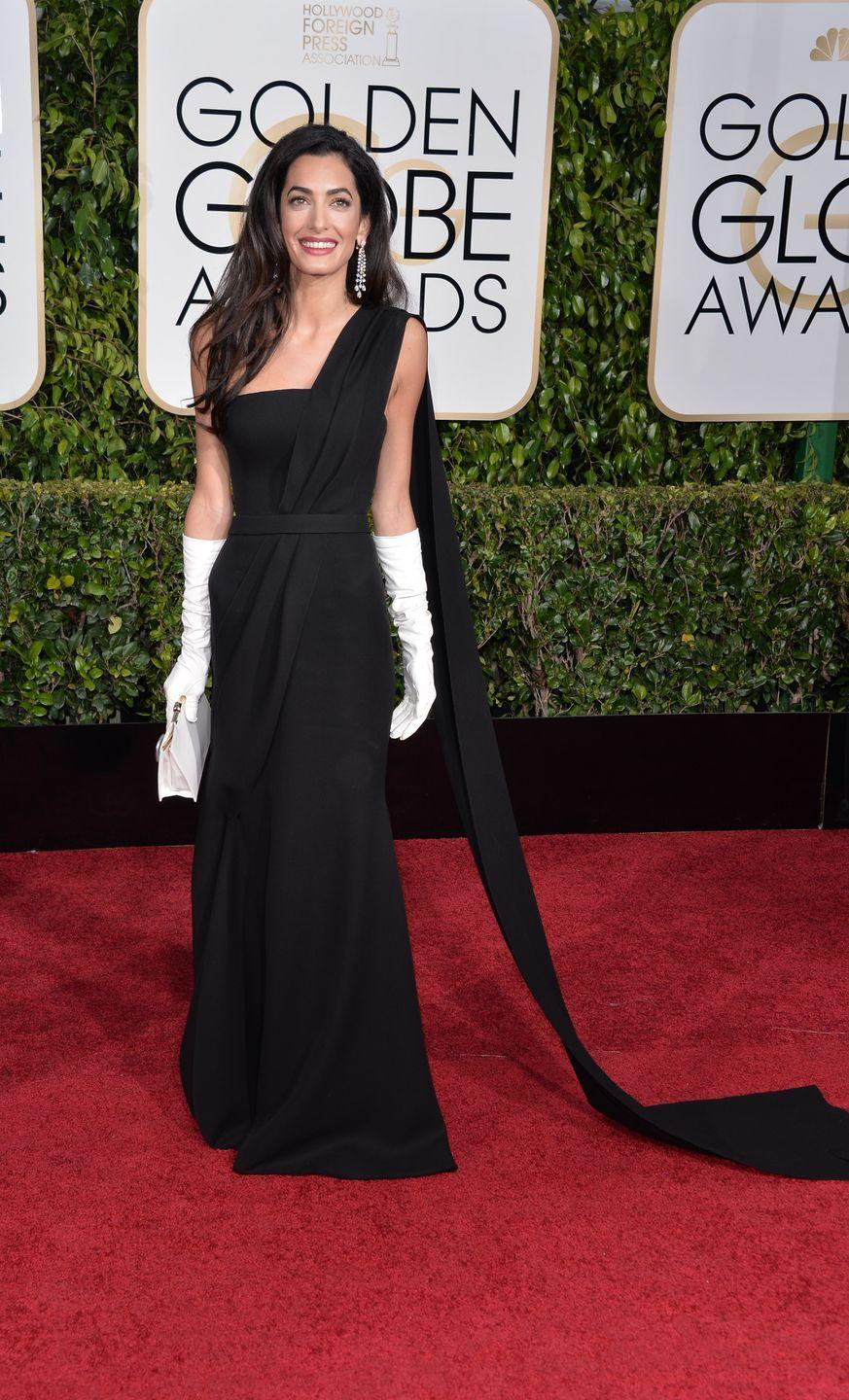 <p>Amal Cooney took style cues from Audrey Hepburn in Breakfast At Tiffany's with her look for the 2015 Golden Globes. In a moment that divided fashion fans, the human rights lawyer paired her black Dior dress with contrasting white elbow-length opera gloves. We personally loved it. </p>
