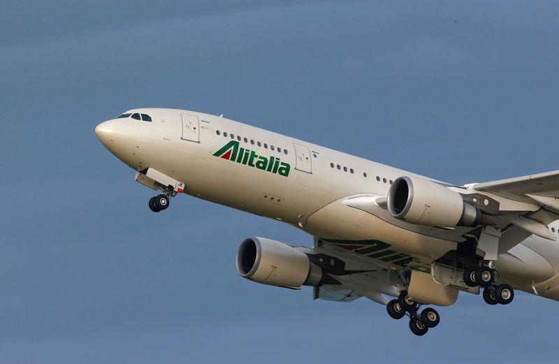 An Alitalia airplane takes off at the Fiumicino International airport in Rome