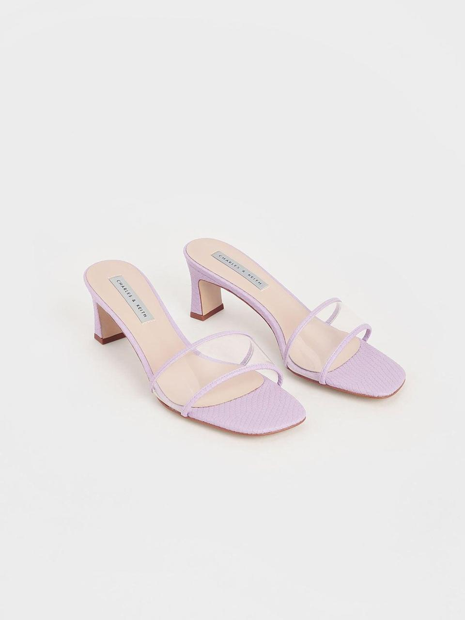 """<br><br><strong>Charles & Keith</strong> Snake Print Clear Strap Mules, $, available at <a href=""""https://go.skimresources.com/?id=30283X879131&url=https%3A%2F%2Fwww.charleskeith.com%2Fus%2Fshoes%2FCK1-60050919_AP.PP.html"""" rel=""""nofollow noopener"""" target=""""_blank"""" data-ylk=""""slk:Charles & Keith"""" class=""""link rapid-noclick-resp"""">Charles & Keith</a>"""