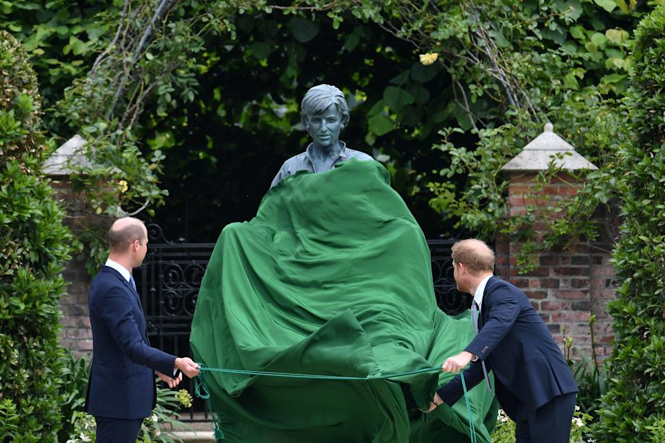 Britain's Prince William, The Duke of Cambridge, and Prince Harry, Duke of Sussex, look at a statue they commissioned of their mother Diana, Princess of Wales, in the Sunken Garden at Kensington Palace, London, Britain July 1, 2021. Dominic Lipinski/Pool via REUTERS