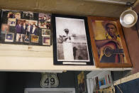 "Portraits of Henry Stuckey, the originator of the Bentonia blues, second from right, and area resident and bluesman Jack Owens, hang high on the wall at the Blue Front Cafe in Bentonia, Miss., Jan. 21, 2021. Blues performer Jimmy ""Duck"" Holmes credits both Stuckey and Owens for having influenced his adoption of the Bentonia style of blues playing. Holmes' ninth album, ""Cypress Grove,"" has earned a Grammy nomination for the Best Traditional Blues Album. (AP Photo/Rogelio V. Solis)"