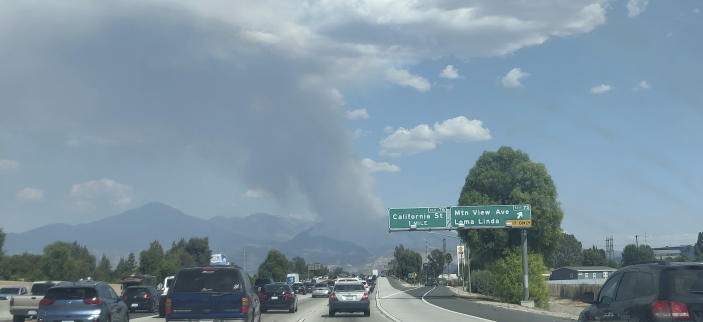 """A plume of smoke from the El Dorado fire is seen from the Interstate 10 in Loma Linda, Calif., Saturday, Sept. 5, 2020. In Southern California, a fast-moving fire in the foothills of Yucaipa has prompted evacuation orders for Oak Glen, a farm community that just opened its apple-picking season to the public. Cal Fire's San Bernardino unit said the fire has scorched at least 800 acres and was burning at a """"moderate to dangerous"""" rate of spread. (AP Photo/Ringo H.W. Chiu)"""