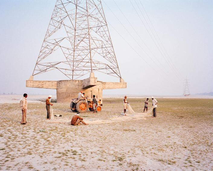<p>The barren riverbed of the Ganges in Kanpur, Uttar Pradesh India, 2014. The riverbed drained, from the barrage, leaves behind a desertlike area where the water used to be. Citizens of the area complain of the poor health of the river, the depletion of the water levels, pollution and the disappearance of river life. (Photograph by Mustafah Abdulaziz/WaterAid) </p>