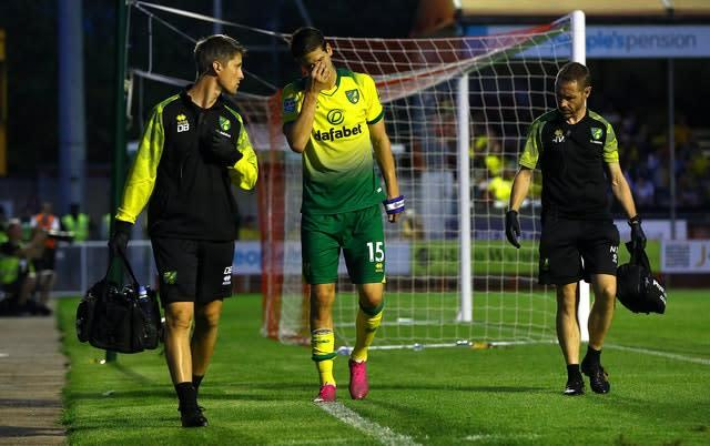 Timm Klose walks off after picking up an injury during the Carabao Cup second-round match at Crawley (Gareth Fuller/PA)