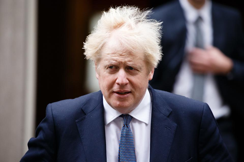 British Prime Minister Boris Johnson leaves 10 Downing Street for the weekly cabinet meeting, currently being held at the Foreign, Commonwealth and Development Office (FCDO), in London, England, on October 13, 2020. (Photo by David Cliff/NurPhoto via Getty Images)