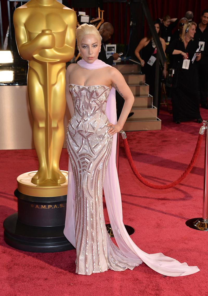 Wearing a lavender Atelier Versace gown at the 86th Annual Academy Awards.