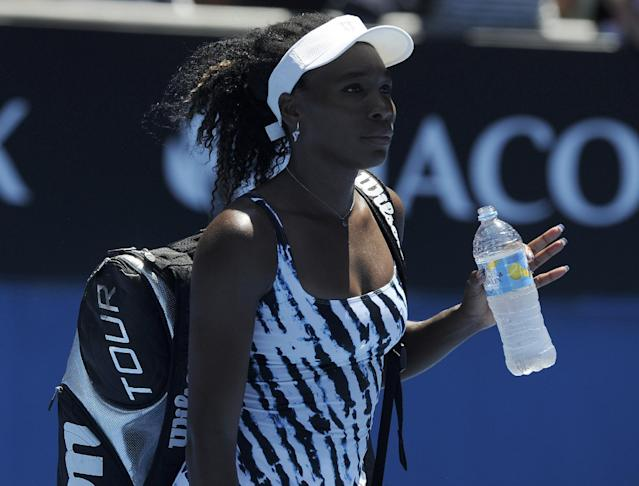 Venus Williams of the U.S. walks from the court following her first round loss to Ekaterina Makarova of Russia at the Australian Open tennis championship in Melbourne, Australia, Monday, Jan. 13, 2014. (AP Photo/Andrew Brownbill)