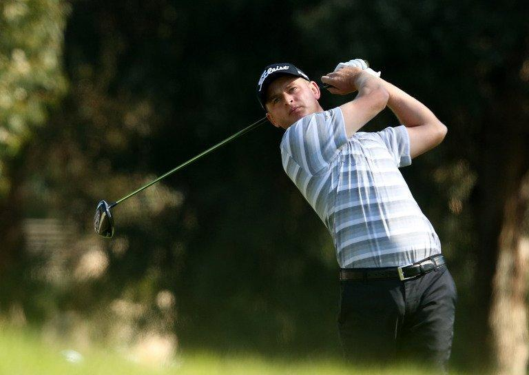 John Merrick tees off during the final round of the Northern Trust Open at Riviera Country Club on February 17, 2013