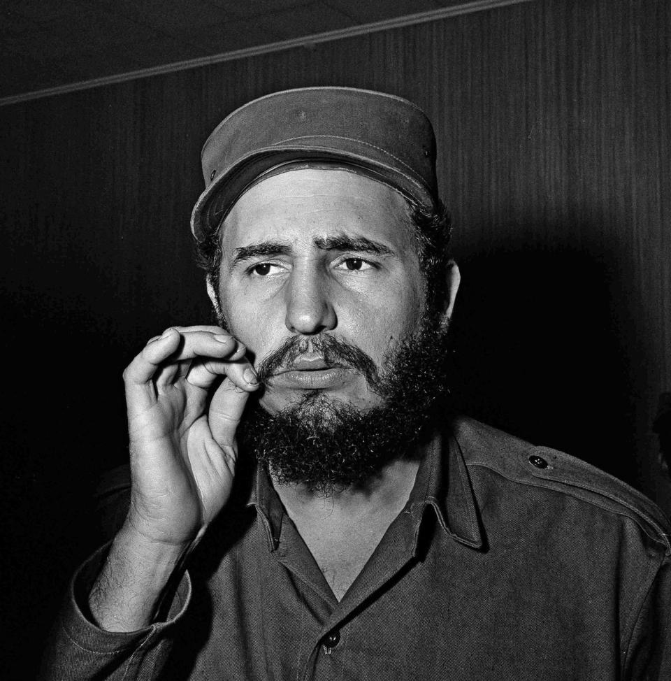 <p>Fidel Castro, leader of Cuba's revolutionary forces, ponders questions at a press conference in Cienfuegos, Jan. 7, 1959. (AP Photo/Harold Valentine) </p>