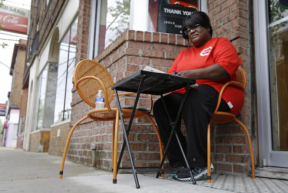 In this Thursday, April 11, 2013 photo, Catherine Jones sits outside her namesake restaurant, in Elmwood Place, Ohio. Jones understands the community's need to install speed cameras to quell speeding, but now she is among many small business owners worried that the cameras have given the village a speed trap stigma. (AP Photo/Al Behrman)