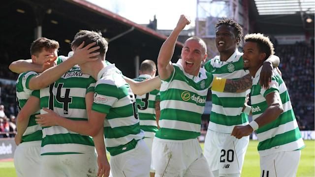 Brendan Rodgers celebrated the first league title of his managerial career as Celtic beat Hearts 5-0 on Sunday to secure the crown.