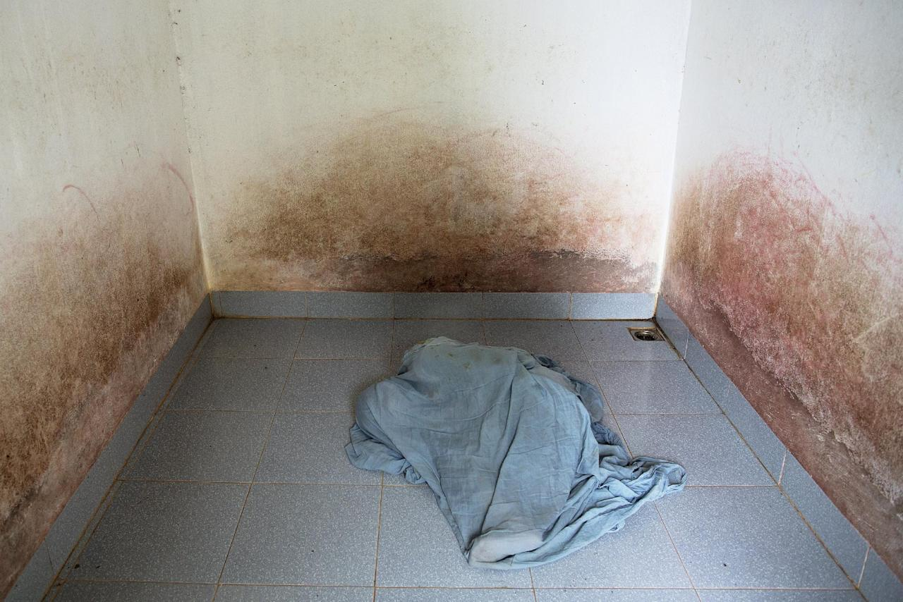 """38-year-old Doan Thi Hong Gam, who suffers from severe mental as well as physical health problems, covers herself with a blanket in an empty room in Thai Binh province, northern Vietnam April 10, 2015. Doan Thi Hong Gam spends her time in an empty room. She is kept isolated because of aggressive behaviour linked to mental health problems. Her father, who suffers from serious heath problems, served as a North Vietnamese soldier during the war and said he was exposed to Agent Orange while fighting in the central highlands. Doan Thi Hong Gam's family and health workers believe her health problems are linked to Agent Orange.  REUTERS/Damir Sagolj    PICTURE 18 OF 24 FOR WIDER IMAGE STORY """"VIETNAM: LEGACY OF AGENT ORANGE""""SEARCH """"AGENT SAGOLJ"""" FOR ALL IMAGES  TPX IMAGES OF THE DAY"""